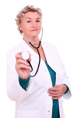 Old female doctor with stroboscope over a white