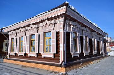 The wooden house with window shutters in  Irkutsk