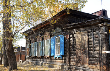The old wooden house with window shutters on Irkutsk street