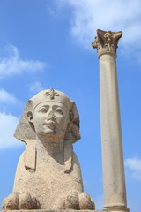 ancient Pompey's pillar and Sphinx in Alexandria, Egypt