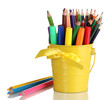 Colorful pencils and felt-tip pens in yellow pail isolated