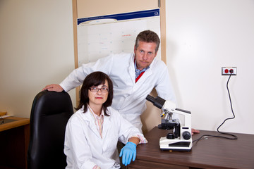 Scientists coworkers near by microscope