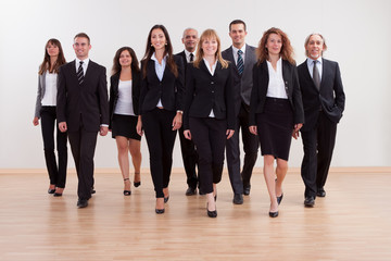 Group of business executives approaching