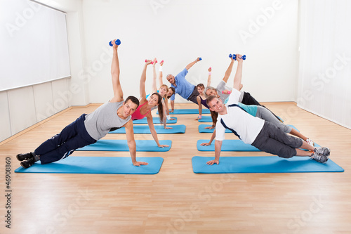 Large group of people working out in a gym