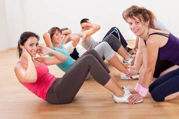 Happy people working out in a gym