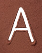 Letter A made of cocoa powder