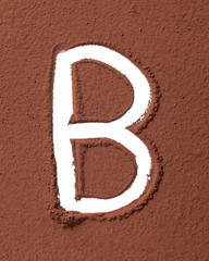 Letter B made of cocoa powder