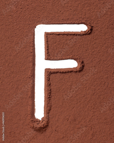 Letter F made of cocoa powder
