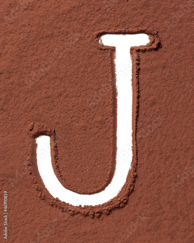 Letter J made of cocoa powder