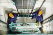Leinwanddruck Bild - machinists adjusting lift in elevator hoistway