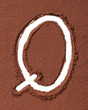 Letter Q made of cocoa powder