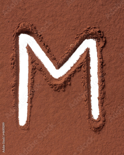 Letter M made of cocoa powder