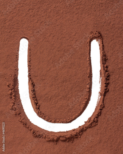 Letter U made of cocoa powder