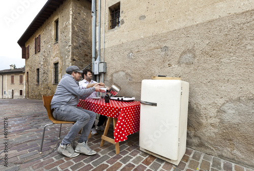 two men and kitchen in exterior