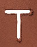 Letter T made of cocoa powder