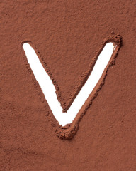 Letter V made of cocoa powder