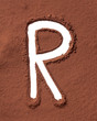Letter R made of cocoa powder