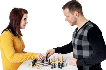 Man and woman playing chess
