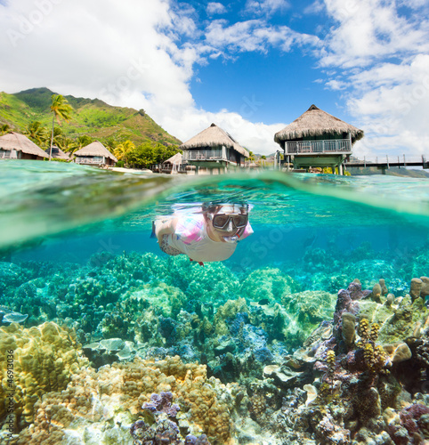 Woman snorkeling at coral reef