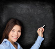 Teacher teaching writing on blackboard