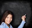 Teacher teaching writing on blackboard