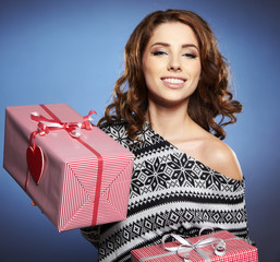 a beauty young girl with christmas gift