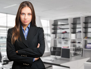 Businesswoman standing in her office