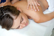 Relaxed woman receiving a massage in a spa