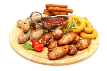 Snacks - chicken wing, sausage and squid rings