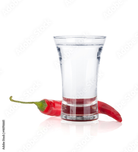 Shot of vodka and red hot chili pepper