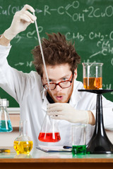 Mad professor holds some experiments in his laboratory