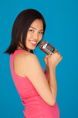 Pretty Young Asian woman with a microphone