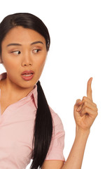 Asian woman pointing up with her finger