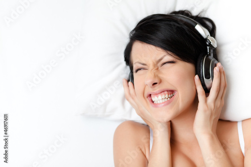 Woman in underwear listens to music