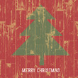 Christmas tree symbol and greetings on wooden planks texture. Ve