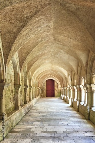 Fototapeta Old colonnaded closter in the Abbaye de Fontenay in Burgundy