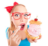 Funny girl eating a cream puff
