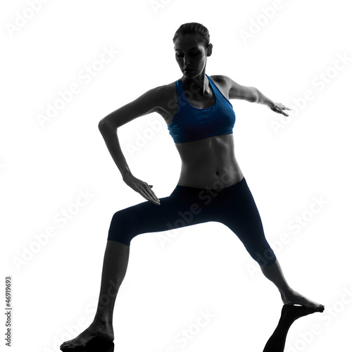 woman exercising yoga warrior position