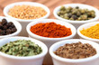 Colorful spices on white pots