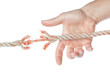 Man's hand catching torn end of the rope. On a white background.