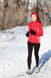 Winter snow runner woman