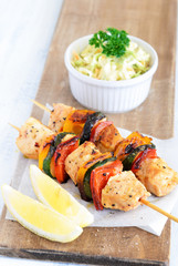 Healthy chicken kebabs and coleslaw
