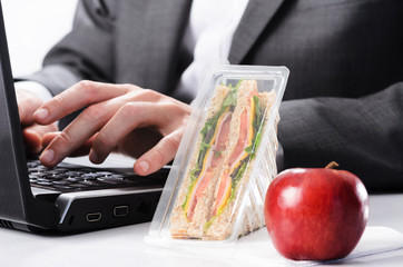 Hardworking businessman with uneaten lunch