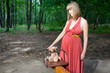 Beautiful pregnant woman in sunny park