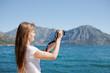 Woman taking snapshot of idyllic mediterrian setting