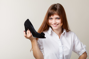 A beautiful woman with a shoe