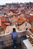 Tourist looking over the roofs in Dubrovnik old town