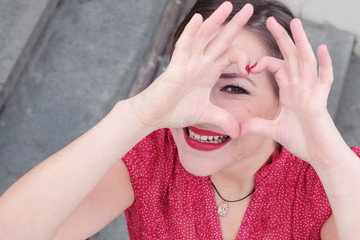 Loving portrait of a smiling girl with red lipstic