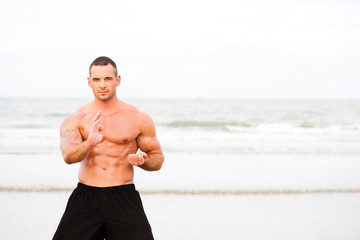 Man doing exercises at the beach