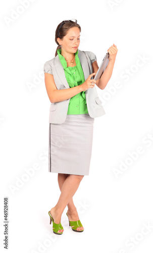 Young beautiful business woman works with tablet in studio